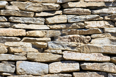 Stone Wall stock photo, A stone wall showing patterns, detail, and texture by Stephen Bonk