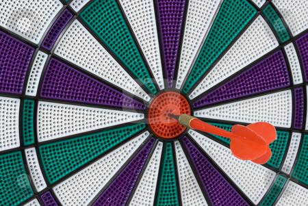 Bullseye stock photo, Dartboard with dart in center (bullseye) by Stephen Bonk