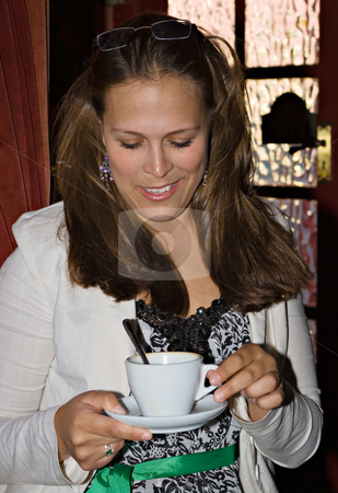 Young Lady and Tea stock photo, A young lady with a cup of tea or coffee by Stephen Bonk