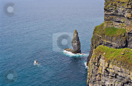 Cliffs of Moher and Boat stock photo, The Cliffs of Moher in Ireland with a boat in the Atlantic Ocean by Stephen Bonk