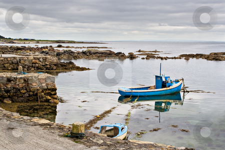 Boat on Galway Bay stock photo, A boat tied up on the edge of Galway Bay, Ireland. by Stephen Bonk