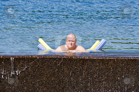 A Man in a Lake stock photo, A adult man cooling off in a lake by Stephen Bonk