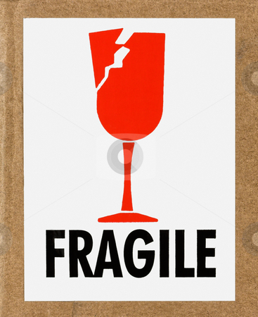 Fragile Label stock photo, Closeup of a fragile sign on a cardboard box by Stephen Bonk