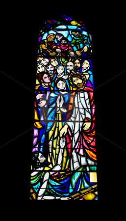 Religious Stained Glass Window stock photo, A religious stained glass window inside a church by Stephen Bonk