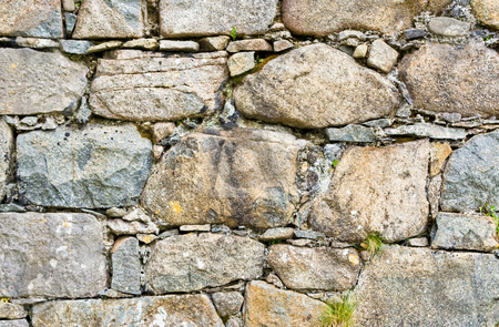 Stone Wall stock photo, Stone wall showing much detail and texture by Stephen Bonk