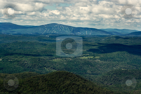 Mountains and Ski Slopes in the Summer stock photo, View of mountains and ski slopes on a summer day. View is from the top of a high mountain in the Green Mountains of Vermont. by Stephen Bonk