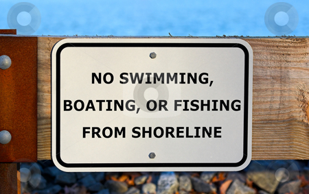 No Swimming, Boating, Fishing stock photo, No swimming, boating, or fishing from shoreline sign at a reservoir by Stephen Bonk