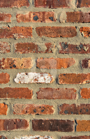 Brick Wall - Portrait Background stock photo, Red brick wall showing detail, patterns, and texture in portrait format by Stephen Bonk