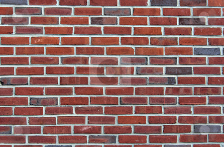 Brick Background stock photo, A red brick background showing detail and texture by Stephen Bonk