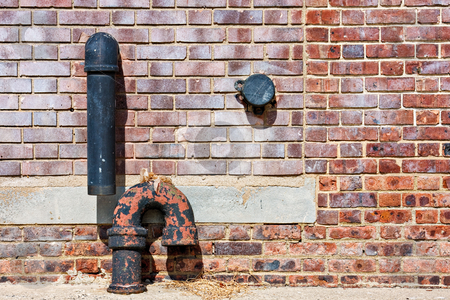 Brick Wall and Pipes stock photo, Abstract of brick wall and pipes by Stephen Bonk