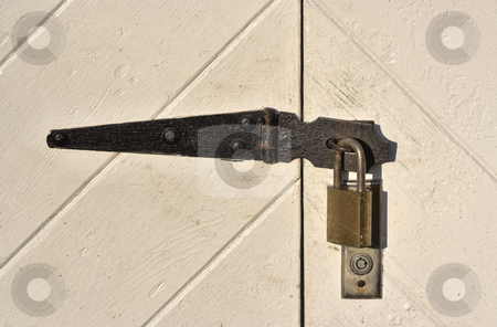Padlock on old doors stock photo, Close up of a padlock on old barn doors by Stephen Bonk