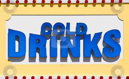 Cold Drinks Sign stock photo, Large sign advertising cold drinks for a restaurant on a beach boardwalk by Stephen Bonk