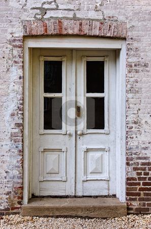Doors stock photo, Front doors of an old brick building by Stephen Bonk