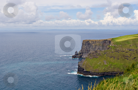 Atlantic Ocean and Cliffs of Moher stock photo, The Cliffs of Moher in County Clare, Ireland. This is on the Atlantic Ocean shoreline. by Stephen Bonk