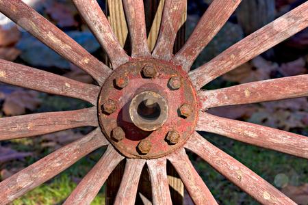 Wagon Wheel stock photo, Closeup of an old, antique wagon wheel by Stephen Bonk