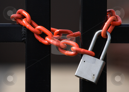 Lock and Chain stock photo, A chain and padlock around a fence by Stephen Bonk