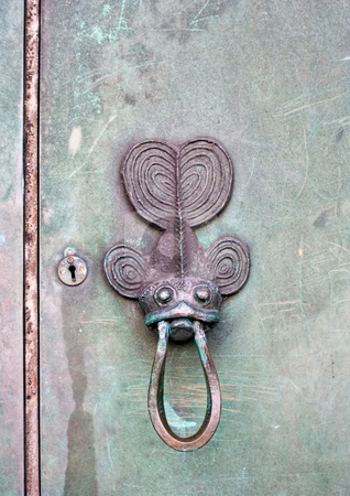 Fish Door Knocker stock photo, An old fish door knocker. by Stephen Bonk