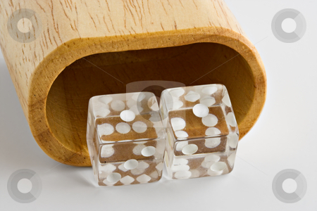 Snake Eyes stock photo, Dice showing snake eyes, double ones, in front of a shaker by Stephen Bonk