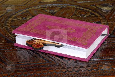 Religious life stock photo, Red Bible book with wooden cross on  table by Julija Sapic