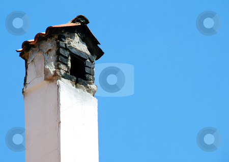 Old chimney stock photo, Old smoky chimney isolated over blue sky by Julija Sapic