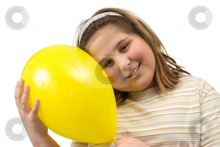 Girl With Balloon stock photo, A young girl smiling and holding a yellow balloon, isolated against a white background by Richard Nelson