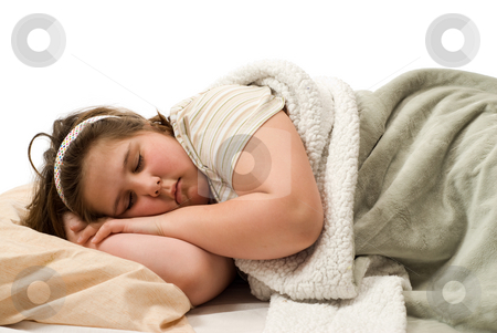 Sleeping stock photo, A young girl lying in bed sleeping all tucked in, isolated against a white background by Richard Nelson