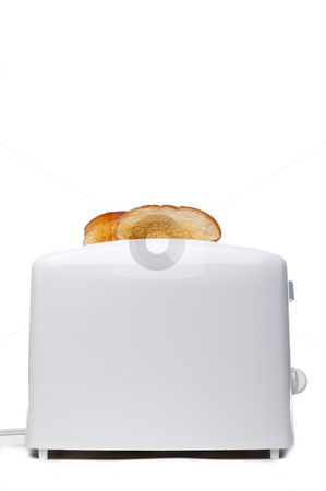 Toasted bread popping up from a white  toaster stock photo, Toasted bread popping up from a white  toaster by Vince Clements