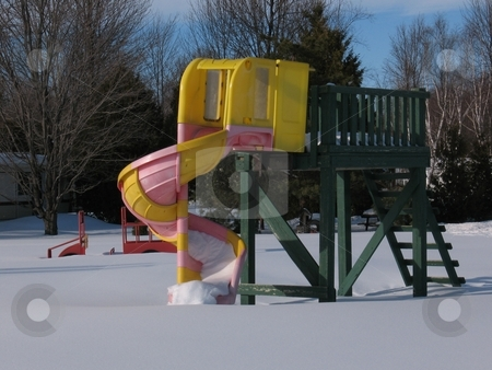A Winter Slide stock photo, A slide in a playground at the height of winter. by Ray Carpenter