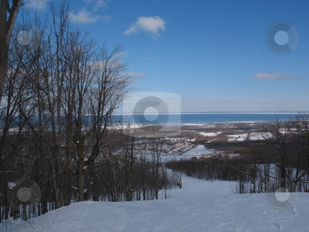 View of Georgian Bay  from Blue Mountain stock photo, A beautiful view of Georgian Bay from the top of Bue Mountain at Collingwood. in February. by Ray Carpenter
