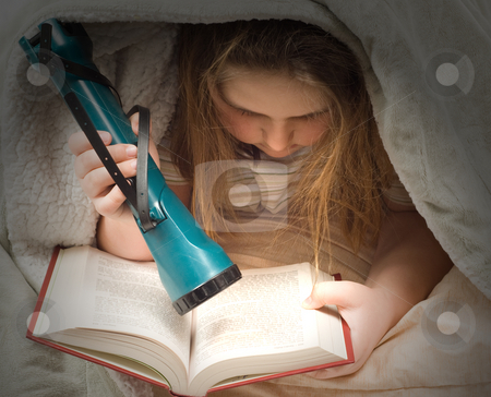 Reading With Flashlight stock photo, A young girl reading a book with a flashlight under some blankets by Richard Nelson