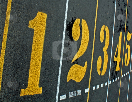 Numbers 1 2 3 4 5 stock photo, Bold numbers in yellow on a paved surface by Tom and Beth Pulsipher