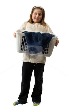 Child Chores stock photo, Full body view of a young girl holding a basket of soiled laundry, isolated against a white background by Richard Nelson