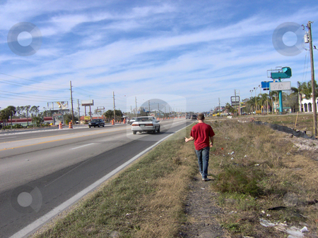 Hitch Hiker stock photo, Hitchhiking on the side of a busy street in Florida, USA. by Todd Arena