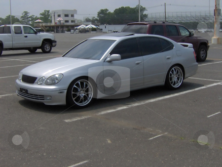 Pimped-Out Luxury Whip stock photo, This is a lexus gs with rims and tints. by Todd Arena