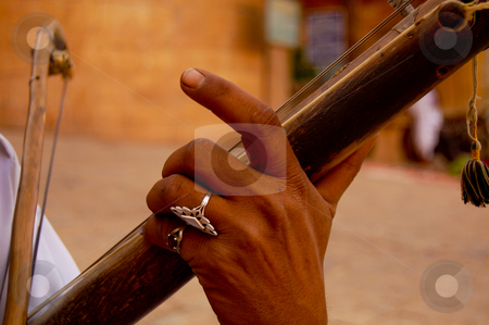 The indian ravanastron stock photo, Ravanastron or ravanatha is an Indian stringed instrument played with a bow, used by wandering pilgrims, particularly in Gujarat and (as in this case) Rajasthan... by Piero Biondo