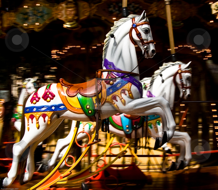 Race ya stock photo, Two colourful wooden carousel horses taken in Provence France by James Janisse