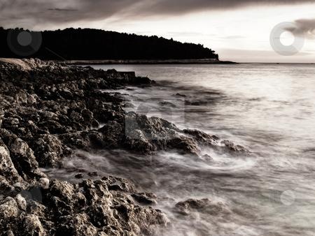 Adriatic sunset stock photo, Sunset on the beach.Rocky adriatic coast on the  island Losinj, Croatia. by Sinisa Botas