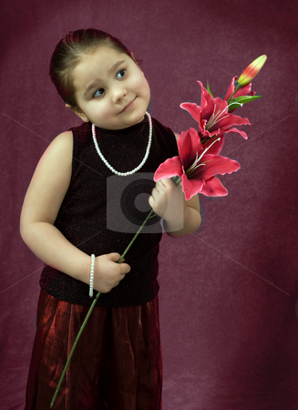 Happy Child stock photo, Portrait of a happy young girl holding some flowers by Richard Nelson