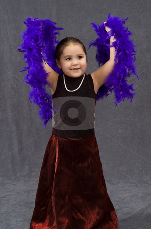 Beautiful Dancing stock photo, A young girl is dancing while wearing a pearl necklace and a feather boa by Richard Nelson