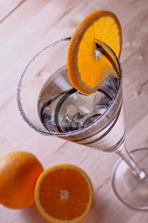 Frosted glass with oranges and a cocktail drink stock photo, Frosted glass cocktail drink decorated with oranges by Mark Allchin