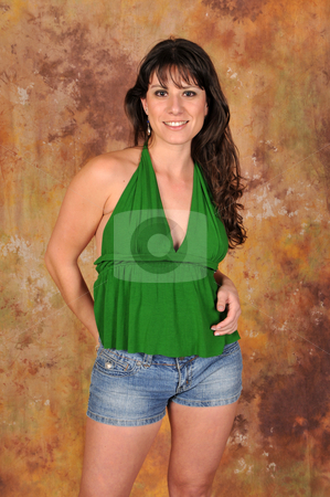 Brunette stock photo, Brown haired beauty in a green halter top and denim shorts by Harris Shiffman