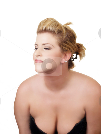 Young woman with low cut dress showing cleavage stock photo, Young woman showing cleavage in black dress by Jeff Cleveland