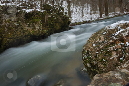 Winter Creek stock photo, Forest creek flowing diagonaly with snow on the banks by Denis Radovanovic