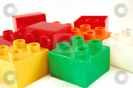 Close-up of plastic blocks on white background stock photo, Close-up of plastic blocks on white background by ALESSANDRO TERMIGNONE
