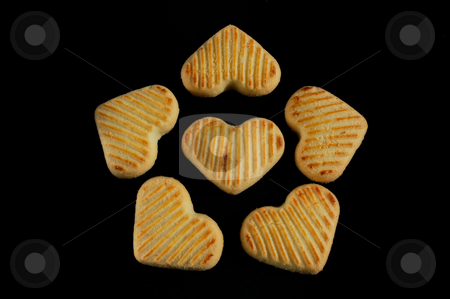 Close-up of cookies on black background stock photo, Close-up of cookies on black background by ALESSANDRO TERMIGNONE