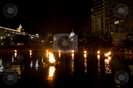 Providence Water Fire stock photo, The burning bowls of fire set on the river during the annual WaterFire event in Providence Rhode Island.  In the background is the famous capital building. by Todd Arena
