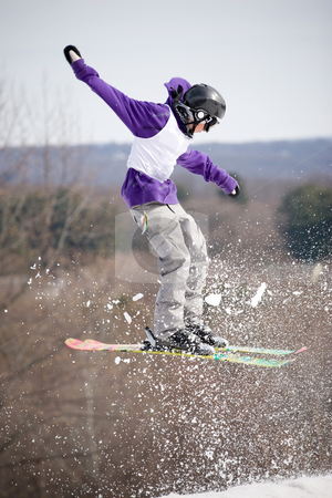 Ski Jumper stock photo, A skier catching some major air after launching off of a jump. by Todd Arena