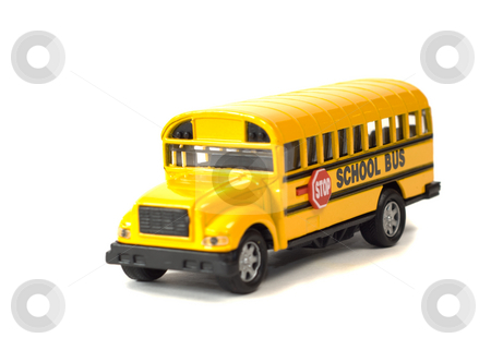 School Bus stock photo, A toy school bus shot on a white background with a shadow underneath by Richard Nelson
