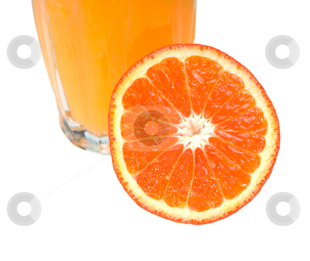 Orange stock photo, Closeup view of an orange next to a glass of juice, isolated against a white background by Richard Nelson