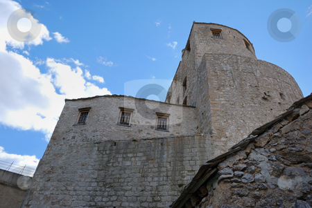 Towers in Mostar Old Town stock photo, Towers in old town in Mostar, Bosnia and Herzegovina with blue sky in background. by Denis Radovanovic